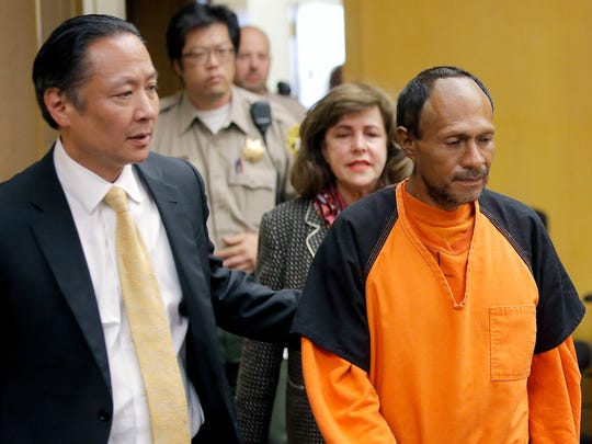 In this July 7, 2015, file photo, Jose Ines Garcia Zarate, right, is led into the courtroom by San Francisco Public Defender Jeff Adachi, left, and Assistant District Attorney Diana Garciaor, center, for his arraignment at the Hall of Justice in San Francisco.