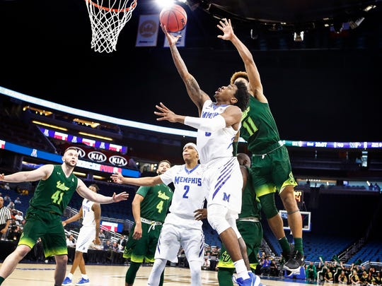 Memphis guard Kareem Brewton Jr. (front) drives for a layup against the USF defense during second half action of their AAC first round tournament game in Orlando, Fl., Thursday, March 8, 2018.