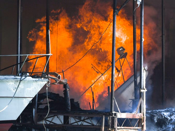 A burning boat sinks under dock six of Portman Marina
