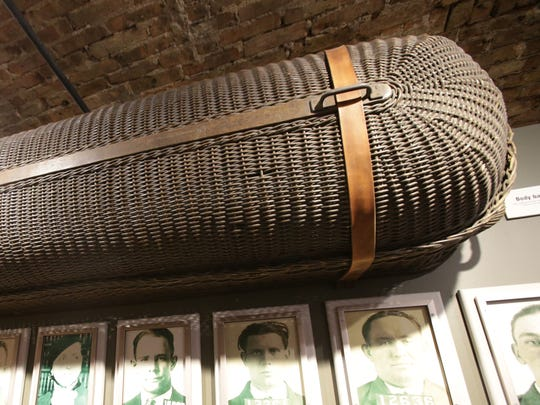 "The wicker basket in which John Dillinger's body was brought back to Indiana hangs in the ""Crime Doesn't Pay"" exhibit."