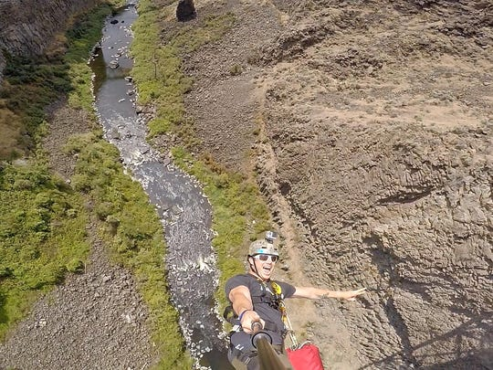 Zach Carbo takes a selfie while bungee jumping into the Crooked River Gorge off High Bridge at Peter Skene Ogden State Scenic Viewpoint. Central Oregon Bungee Adventures offers the jump now, in an agreement with the Oregon Parks and Recreation Department.