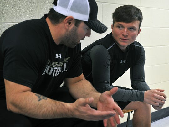 Trainer Jerry Hughes, left, talks with his client, Andy Albertson who lost more than 170 pounds over two years. Hughes helped Albertson establish a nutrition plan and workout regimen.