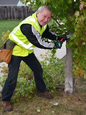 Spring and fall, Don Wood takes to the streets in West Lafayette as a volunteer tree pruner.