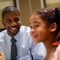 Former Waverly High School and MSU basketball player Marcus Taylor laughs as he jokes around with teammates from Waverly before the start of the Lansing Sports Hall of Fame banquet Thursday, July 28, 2016 at the Lansing Center. Taylor's 2000 state championship basketball team was being inducted into the hall.