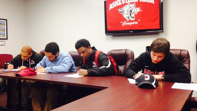 Asheville High football players, from left to right, Jave Jones, Holton Brown, Tyreek Smith and Alexander Paulk signed with colleges in February.