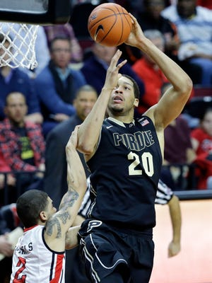 Purdue center A.J. Hammons (20) takes a shot as he is fouled by Rutgers guard Bishop Daniels (2) during the first half of an NCAA college basketball game, Thursday, Feb. 12, 2015, in Piscataway, N.J. (AP Photo/Mel Evans)