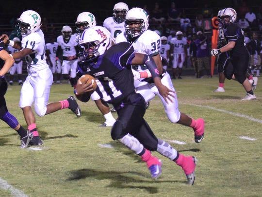 Marksville's Laqaaron Mingo (11) runs for a touchdown against Peabody Thursday.