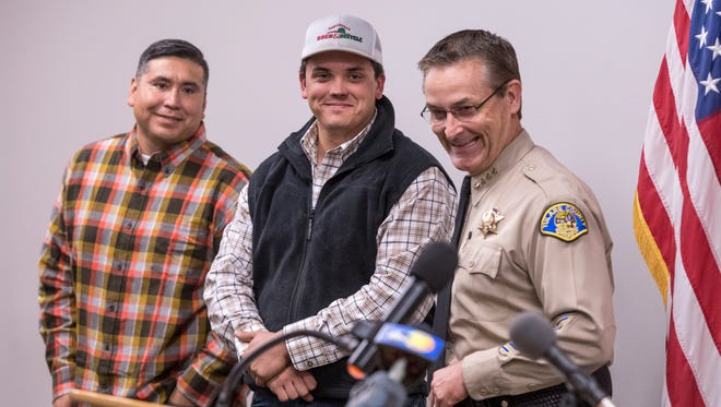 Tulare County Sheriff Mike Boudreaux, right, presents the STAR (Sheriff  of Tulare Action Recognition) Award to Michael Correia and Carlos Martinez on Tuesday, November 28, 2017. Martinez helped save a man attempting suicide. Corriea stopped to help extinguish a vehicle fire on Highway 65.