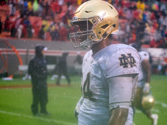 A soggy DeShone Kizer leaves the field on Oct. 8, 2016,