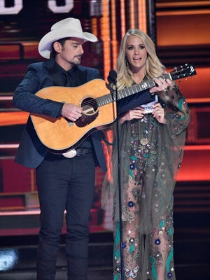 Hosts Brad Paisley and Carrie Underwood perform during the CMA Awards Wednesday, Nov. 8, 2017 at Bridgestone Arena in Nashville, Tenn.
