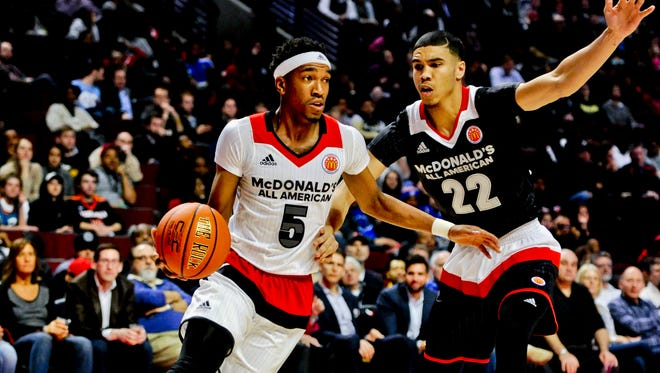 West shooting guard Malik Monk, left, from Bentonville, Ark., drives the ball against East forward Jayson Tatum, from Chaminade College Preparatory school in St. Louis during the McDonald's All-American boys basketball game, Wednesday, March 30, 2016, in Chicago. The West beat the East 114-107.