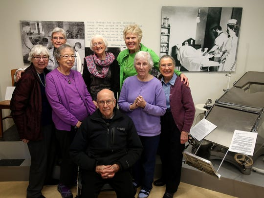 Dr. Joe Treleaven gathers at the Mental Health Museum with nurses he helped train during their rotation at the Oregon State Hospital in 1954.