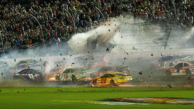 Austin Dillon (3) hits the catch fence following the finish of the Coke Zero 400 at Daytona International Speedway.