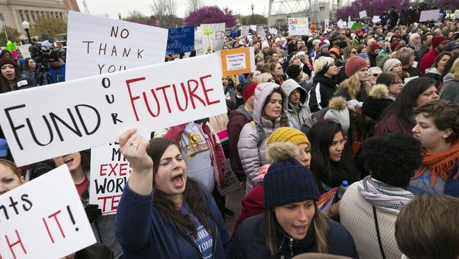 Sheridan Zuniga (center left) and Maria Merino, (center right) both Tulsa, Oklahoma, elementary school teachers strike with other Oklahoma teachers at the Oklahoma state capitol in Oklahoma City on Monday, April 2, 2018.