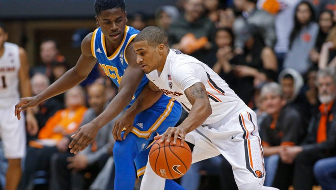 Oregon State's Gary Payton II, right, is guarded by UCLA's Aaron Holiday during the first half of an NCAA college basketball game in Corvallis, Ore., Wednesday, Jan. 20, 2016.