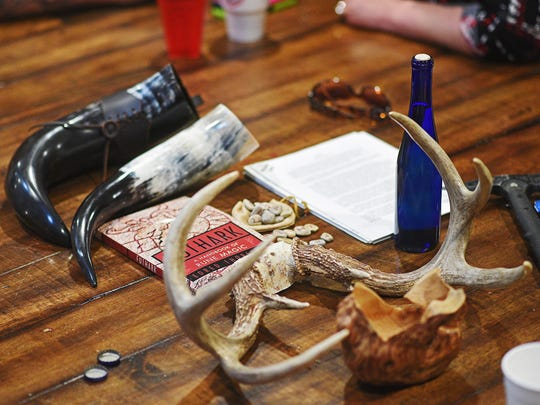 Items of religious significance in the center of a table during an Asatru study group Wednesday, May 10, 2017, in Sioux Falls. Asatru is a pagan Norse religion. The group meets every other Wednesday.
