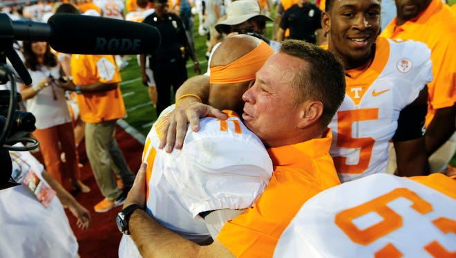 Will head coach  Butch Jones hugs quarterback Joshua Dobbs (11) have the same joyful hug after Saturday's game against No. 1 Alabama.