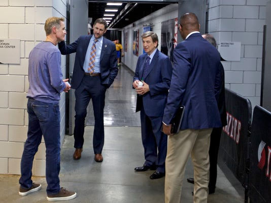 Golden State Warriors head coach Steve Kerr, left, talks with TNT broadcasters Brent Barry, center, and Marv Albert before Game 4 of an NBA basketball first-round playoff series Monday, April 24, 2017, in Portland, Ore. Kerr is not coaching the game due to illness, but is in the arena. (AP Photo/Craig Mitchelldyer)