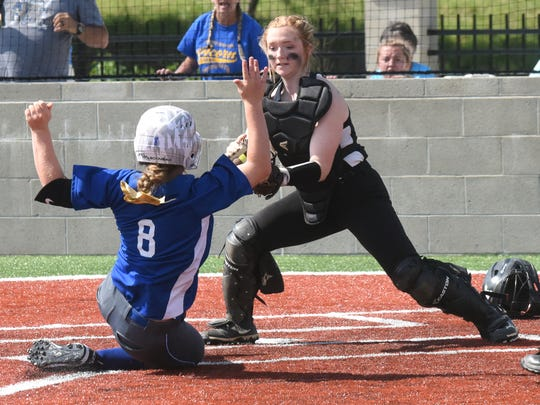 Calico Rock catcher Camryn Cook applies a tag to Acorn's