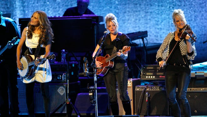 Emily Robison, from left, Natalie Maines and Martie Maguire of the Dixie Chicks perform Oct. 18, 2007, at the Nokia Theatre in Los Angeles.