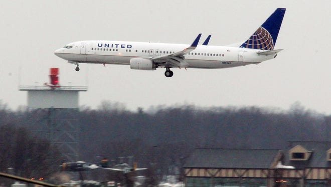 In this Feb. 1 photo, a United Airline jet prepares to land at Cleveland Hopkins International Airport.