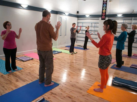 Neil Meisel leads a yoga class at The Awareness Center in Newark earlier this week.