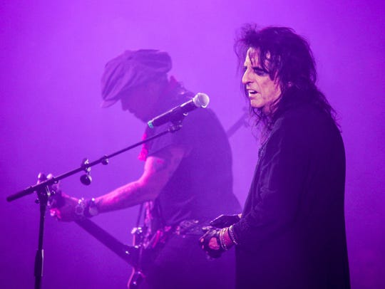 Alice Cooper and Johnny Depp seen performing with Hollywood Vampires at Alice Cooper's Christmas Pudding in 2016.