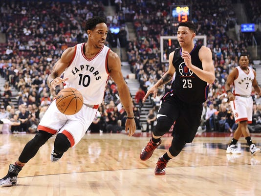 Toronto Raptors guard DeMar DeRozan (10) drives past LA Clippers guard Austin Rivers (25) during first half NBA basketball action in Toronto on Monday, Feb. 6, 2017. (Frank Gunn/The Canadian Press via AP)