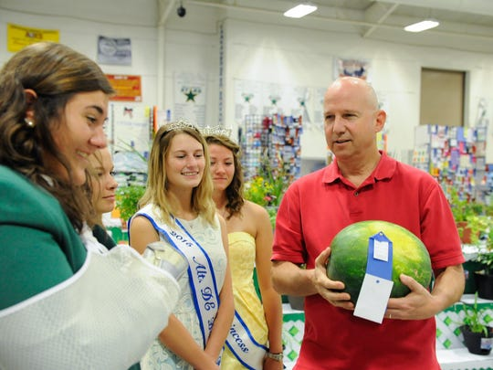 Gov. Jack Markell tours 4-H displays at the Delaware State Fair in Harrington on Thursday, Governor's Day at the fair. The fair runs through Saturday.