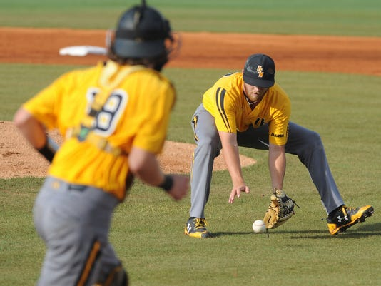 Southern Miss starting pitcher Colt Smith fields a short grounder during their game against Mississippi State in their NCAA regional college baseball game Monday, June 5, 2017, in Hattiesburg Miss. (Ryan Moore/WDAM via AP)