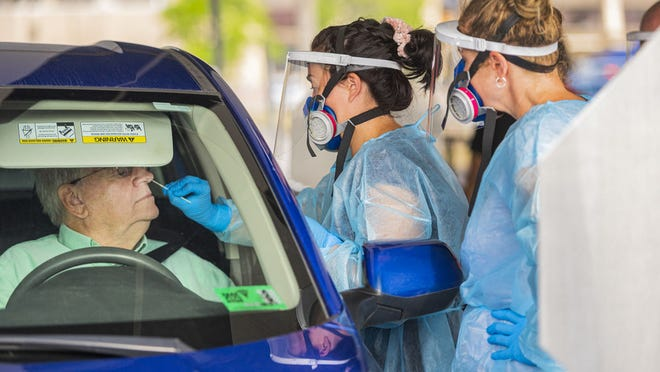 WVU School of Public Health Clinical Associate Professor, Occupational and Environmental Health Sciences member Michael McCawley uses the drive thru Covid -19 testing facilities at the WVU Coliseum parking lot made available to the WVU employee community, July 20, 2020.