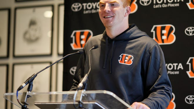 Cincinnati Bengals quarterback Andy Dalton (14) takes questions from the local media during a practice session leading up to the Bengals Sunday NFL International Series game against the Washington Redskins at Allianz Park in London on Friday, Oct. 28, 2016.