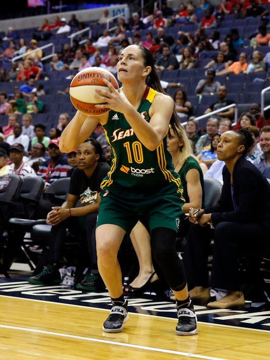 """FILE - In this May 24, 2014, file photo, Seattle Storm guard Sue Bird (10) shoots during the second half of a WNBA basketball game against the Washington Mystics, in Washington. For the first time since the 2009 All-Star Game the league will have a 3-point shootout during halftime of the game on July 22 in Seattle. """"The 3-point contest is something we've had before and I've participated in,"""" said Sue Bird. """"It's fun and great for the fans and players. Everyone enjoys it."""" (AP Photo/Alex Brandon, File)"""