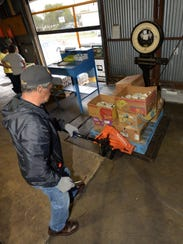 FILE PHOTO: Food pallets are weighed as they are picked up by the various charities working with the Food Bank of Northwest Louisiana.