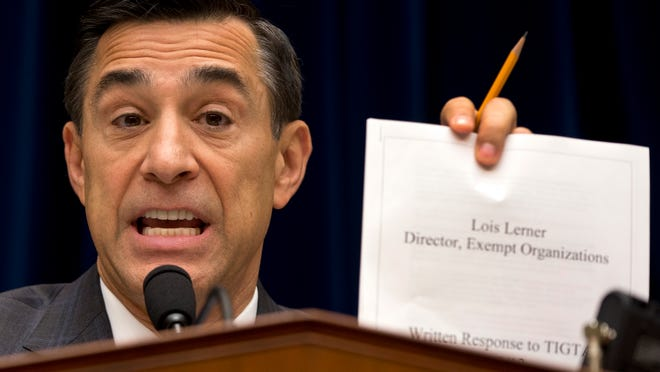 House Oversight Committee Chairman Rep. Darrell Issa, R-Calif. holds up a document as he speaks to IRS official Lois Lerner on Capitol Hill in Washington, Wednesday, May 22, 2013, during the committee's hearing to investigate the extra scrutiny IRS gave to Tea Party and other conservative groups that applied for tax-exempt status.  Lerner told the committee she did nothing wrong and then invoked her constitutional right to not answer lawmakers' questions. (AP Photo/Carolyn Kaster) ORG XMIT: DCCK102