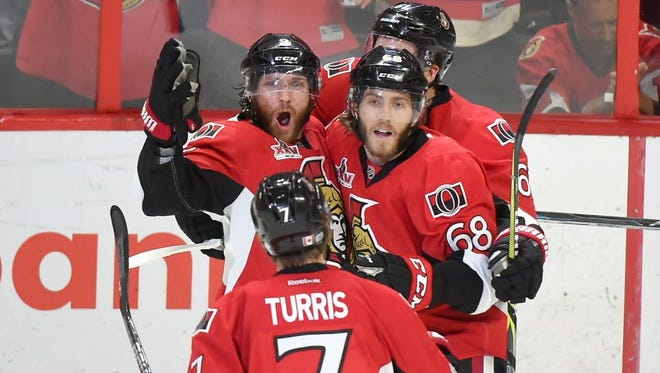 Ottawa Senators forward Bobby Ryan (9) celebrates a goal against the Pittsburgh Penguins with teammates in the second period of Game 6.