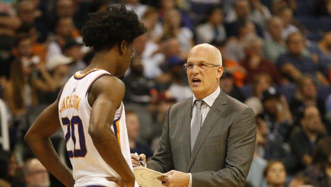 Phoenix Suns head coach Jay Triano talks with forward Josh Jackson (20) during the second quarter against the Milwaukee Bucks at Talking Stick Resort Arena in Phoenix, Ariz. November 22, 2017.