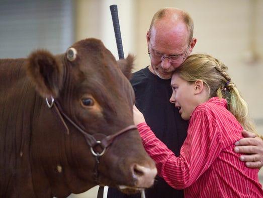 Randy Hocker of Loveland comforts his daughter, Sydney,