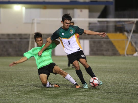 University of Guam Tritons' Will Naden wins the ball in midfield against Islanders FC in a Division II match of the Budweiser Soccer League Dec. 2, 2016, at the Guam Football Association National Training Center. The Islanders defeated UOG 5-1.