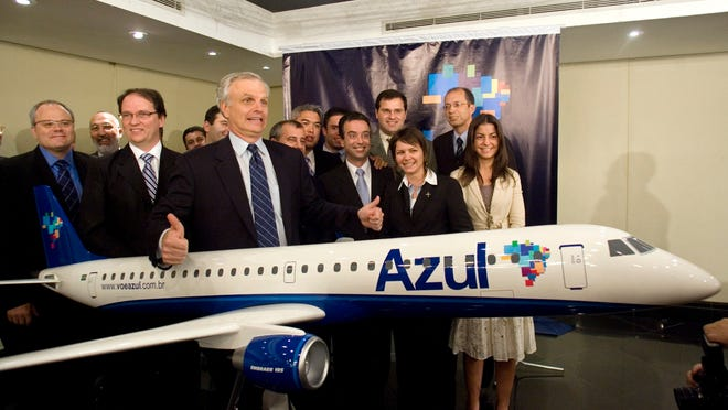 David Neeleman, with thumbs up, poses for a picture with an Azul Airlines model airplane at a news conference in Sao Paulo to announce the new airline on May 28, 2008.
