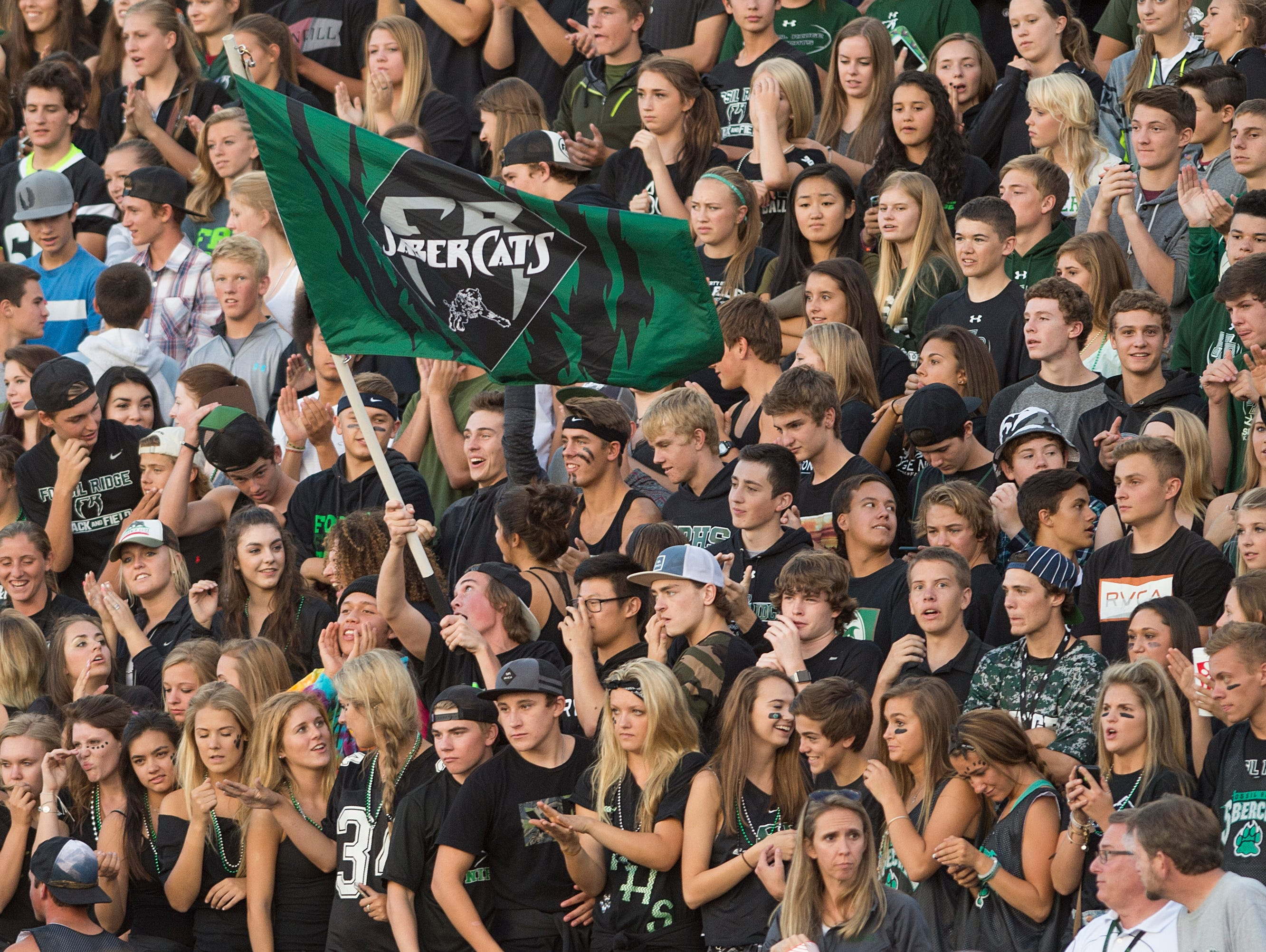 Fossil Ridge High School football fans cheer for their team as they take on Boulder High School at French Field Thursday, September 3, 2015.