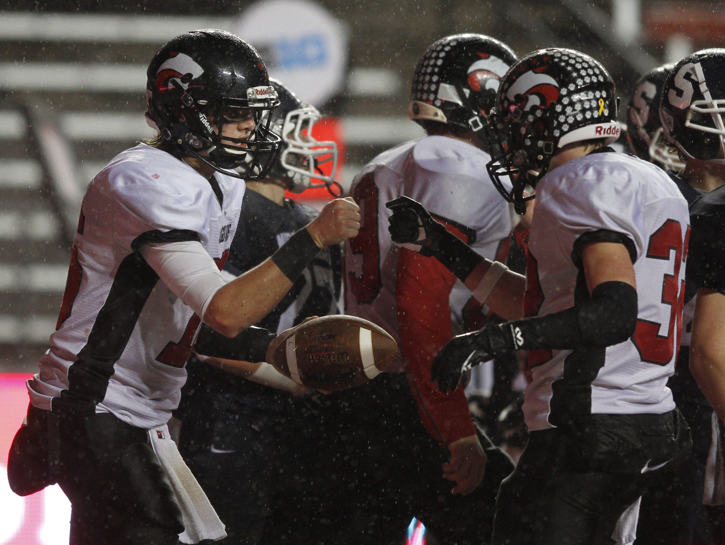 Jackson Memorial players celebrate a touchdown during their victory over Middletown South in the 2014 CJ Group IV final at Rutgers.