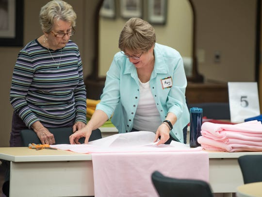 George Award winner Mary Embury helps Ann Maddox with