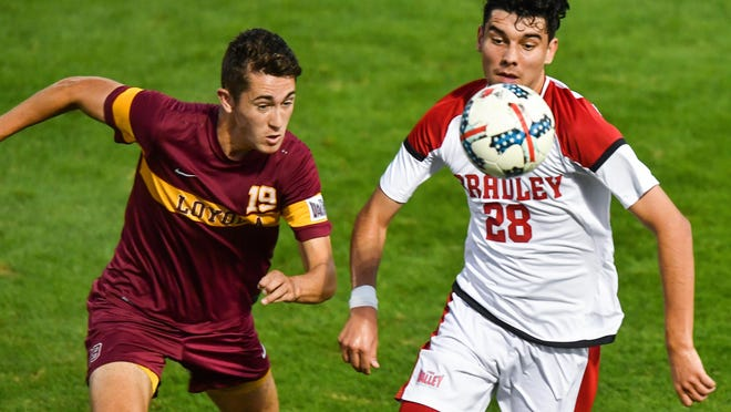 Jordan Walpole of Bradley eyes the ball with Aiden Megally of Loyola during an MVC soccer game in 2018. Walpole and the Braves found out Monday they'll have a shortened season this fall.