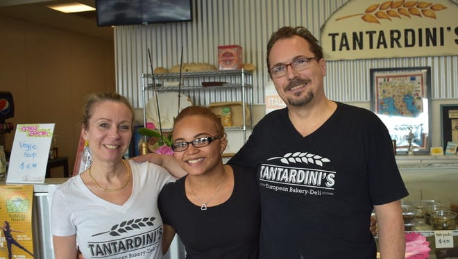 Deborah and Diego Tantardini with high school intern Blu Anderson at their deli.