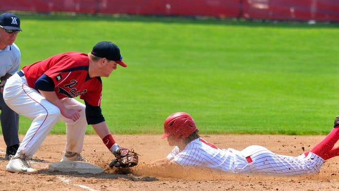 Pacelli third baseman Jake Thomas, left, applies a tag on Marathon's Noah Dirks during the fifth inning of Tuesday's Division 3 sectional semifinal baseball game at Marathon.
