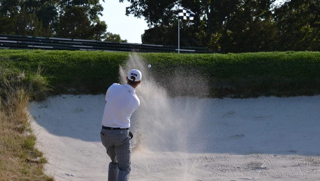 Mount Kisco C.C. head pro Chris Case splashes out of a greenside bunker Wednesday during the second round of the New York State Open at Bethpage Black. He shot a 1-over 72 and is tied for 11th heading into the final round at 4-over.