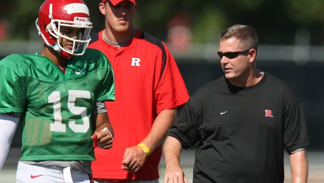 Frank Cignetti (black shirt) talks with quarterback Gary Nova when both were at Rutgers in 2011.