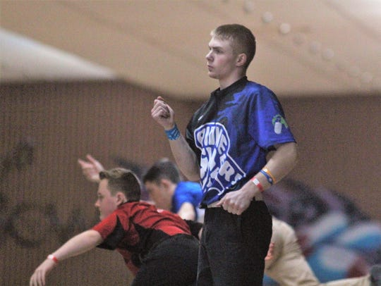 Jonathan Cummins of Simon Kenton reacts to his shot
