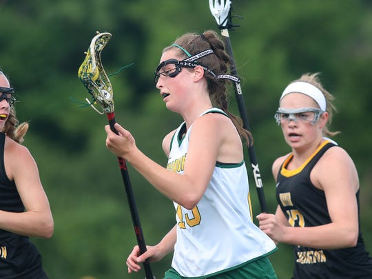 Sycamore's Morgan Bates advances the ball during the Aviators Lacrosse match against  Upper Arlington during their regional final, Wednesday, May 30,2018.